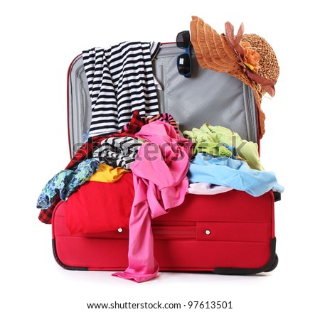 Open red suitcase with clothing isolated on white - stock photo