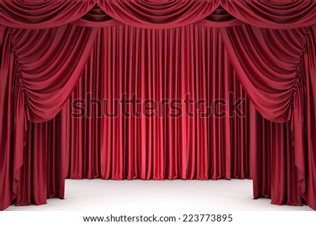 Open red theater curtain, lit by a spotlight - stock photo