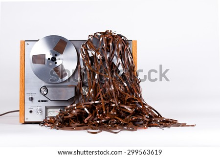 Open Reel Tape Deck Recorder Player with Messy Entangled Tape - stock photo