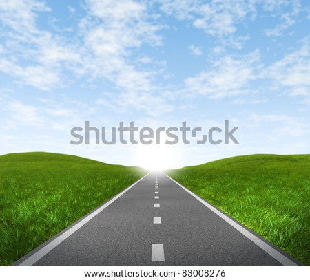Open road highway with green grass and blue sky with an asphalt street representing the concept of journey to a focused destination resulting in success and happiness.