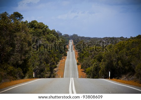 Open road in Australia stretching into distance. Landscape. - stock photo