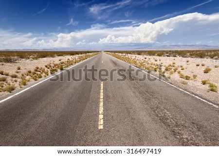 Open Road in Mohave Desert, CA - stock photo