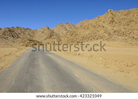Open road in the desert - stock photo