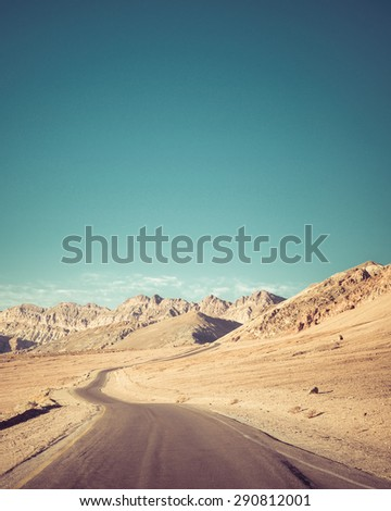 Open road to inspirational Artists Point drive  at Death Valley national Park.Artistic Instagram style processing. - stock photo