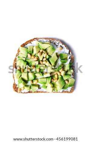 open sandwich with chopped avocado and cedar nuts