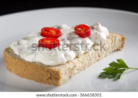 Open sandwich with cream made from cheese, horseradish and ham - stock photo