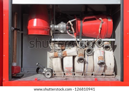 Open side of the fire engine with fire equipment - stock photo