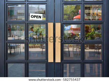 Open sign board hanging on door of cafe. & Open Sign Board Hanging On Door Stock Photo (Royalty Free) 582755437 ...