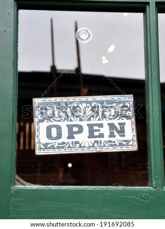 Open sign hang on the  glass door - stock photo