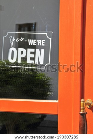 Open sign in street cafe, vertical shot - stock photo