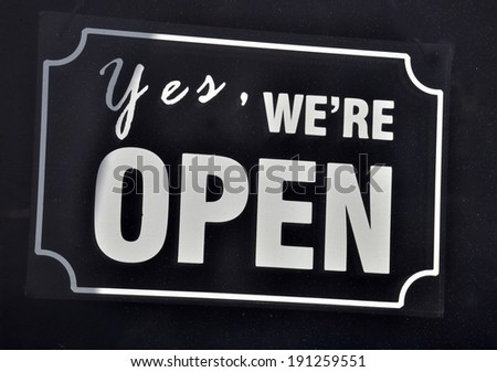 Open Sign on black background - stock photo