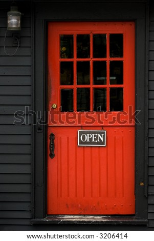 Open sign on red door in Massachusetts vacation town - stock photo