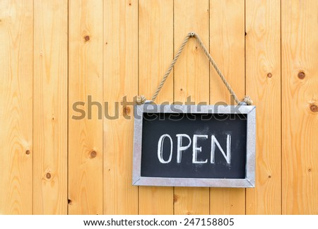 open sign on wooden door - stock photo