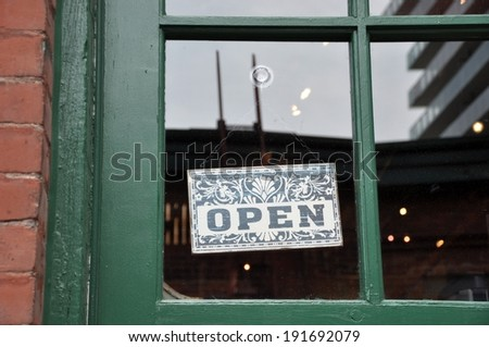 Open signage hang on the glass door - stock photo