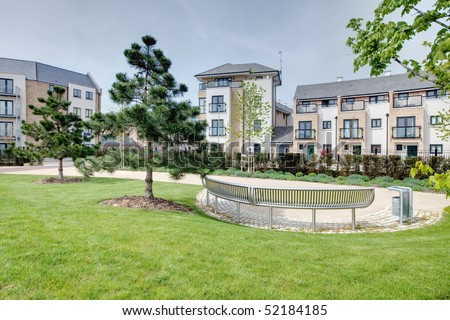 Open space within modern housing scheme typical of that currently under construction.  Cambridge, England - stock photo