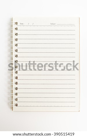 Open spiral notebook, empty line paper with date and subject at header - notebook paper on white background