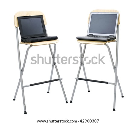open standing on high, bar chair two laptops, black one and silver one, white background