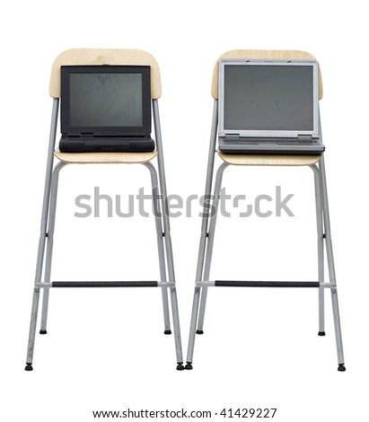 open standing on high, bar chairs two laptops, black and gray one, white background.  This standing front to photo