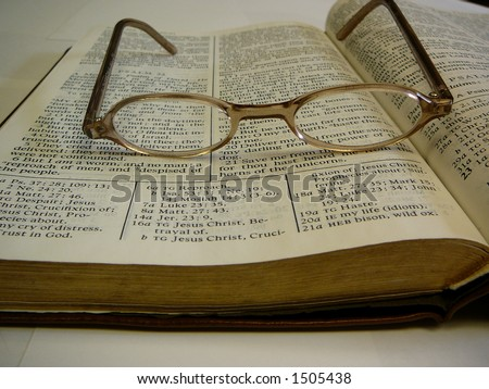 Open Study Bible With Eye Glasses on Top