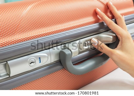 open suitcase with security code - stock photo