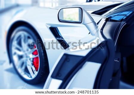 Open Super Car Door Inviting Potential Buyer. Car Market Concept Photo. - stock photo