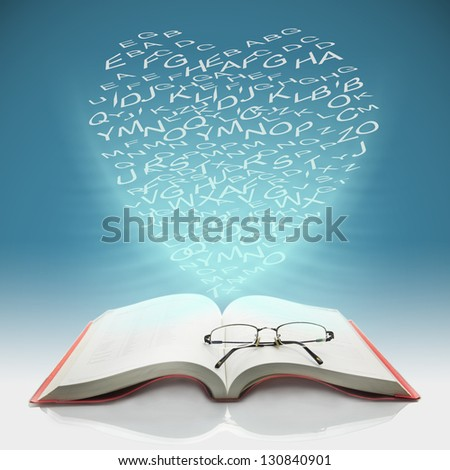 Open the book to have heart shaped letters - stock photo