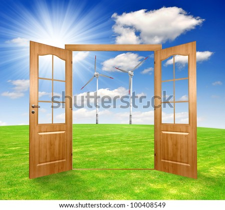 Open the door to the spring landscape with  wind turbines - stock photo
