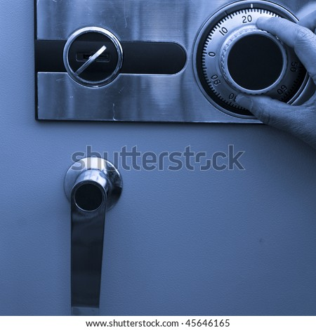 open the steel safe,finger turn it of a man. - stock photo