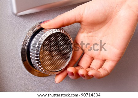 open the steel safe,finger turn it of a  woman - stock photo