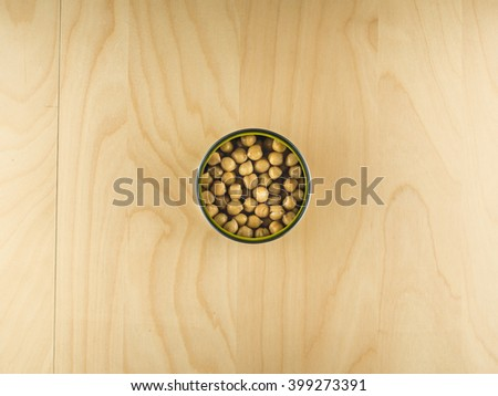 Open tin can with chickpeas, healthy diet - stock photo