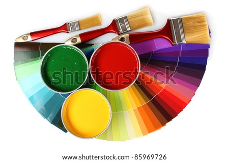 open tin cans with paint, brushes and palette isolated on white - stock photo