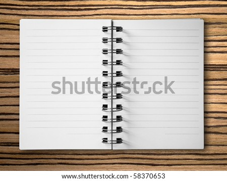 open two face notebook on zebrano Wood background
