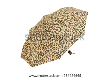 Open  umbrella with abstract leopard elements isolated on white - stock photo