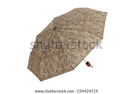 Open  umbrella with abstract leopard elements isolated on white with clipping path - stock photo