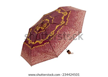 Open  umbrella with abstract red leopard elements isolated on white with clipping path - stock photo