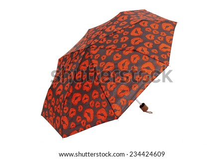 Open umbrella with kisses elements isolated on white with clipping path - stock photo