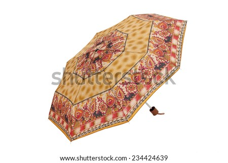 Open  umbrella with red abstract elements isolated on white with clipping path - stock photo