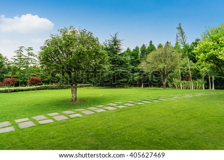 Open Urban Green Park Space in front of Residential Buildings - stock photo