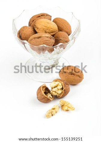 open walnuts in dish closeup on white background - stock photo