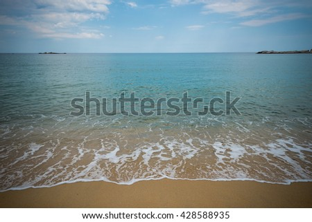 Open water Beach scene showing sand, sea and sky
