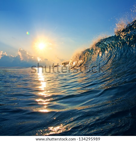 open water landscape rough colored ocean wave breaking at sunset time - stock photo