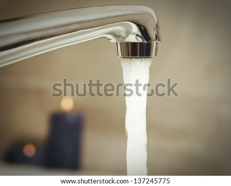open water tap with running water in spa salon.selective color - stock photo