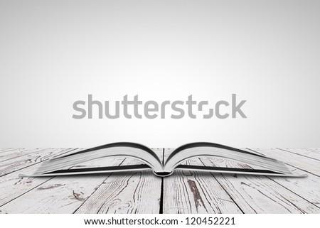 open white book on wooden floor - stock photo