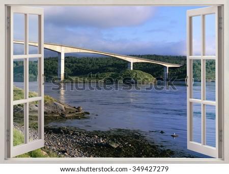 Open window view to bridge over river - stock photo