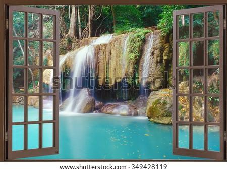 Open window view to deep jungle waterfall - stock photo