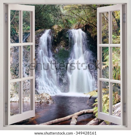 Open window view to Hogarth Falls - a pleasant little waterfall nestled in the People s Park in the quaint coastal township of Strahan,Tasmania,Australia - stock photo