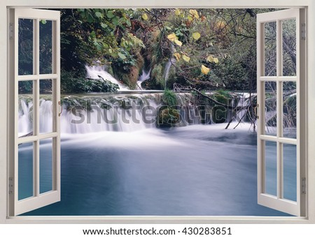 Open window view to small waterfall on the river - stock photo