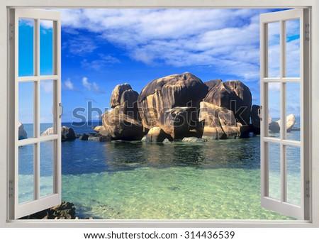 Open window view to very old stones coastline, Seychelles - stock photo