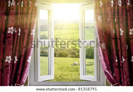 Open window with countryside view and sunlight streaming in - stock photo