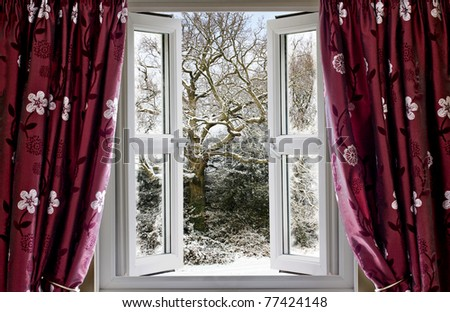 Open window with view to a snowy winter scene - stock photo
